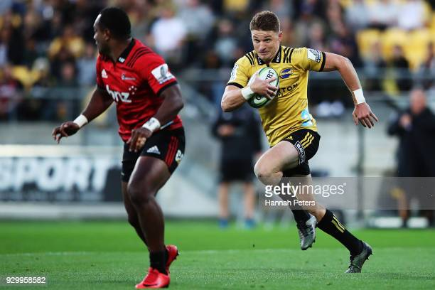 Beauden Barrett of the Hurricanes makes a break during the round four Super Rugby match between the Hurricanes and the Crusaders at Westpac Stadium...
