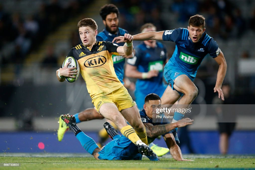 Beauden Barrett of the Hurricanes makes a break during the round eight Super Rugby match between the Blues and the Hurricanes at Eden Park on April 15, 2017 in Auckland, New Zealand.