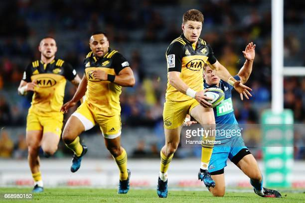 Beauden Barrett of the Hurricanes makes a break during the round eight Super Rugby match between the Blues and the Hurricanes at Eden Park on April...