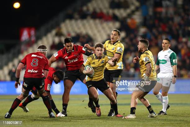 Beauden Barrett of the Hurricanes makes a break during the Super Rugby Semi Final between the Crusaders and the Hurricanes at Orangetheory Stadium on...