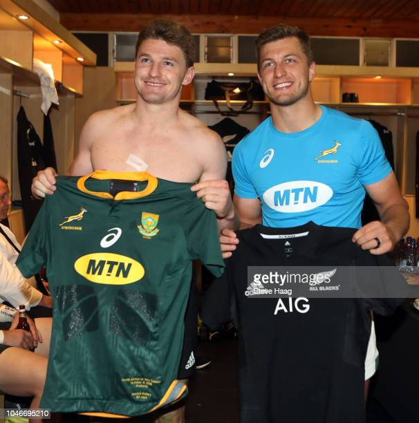 Beauden Barrett of the New Zealand All Blacks and Handre Pollard of South Africa pose in the changing room after the Rugby Championship match between...