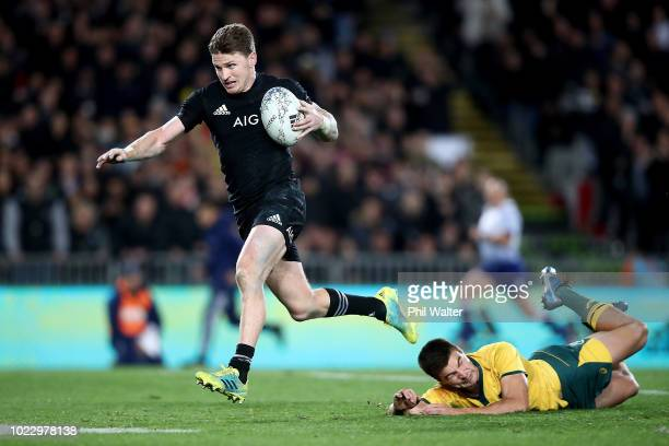 Beauden Barrett of the New Zealand All Blacks breaks the Wallaby defence to score his third try during The Rugby Championship game between the New...