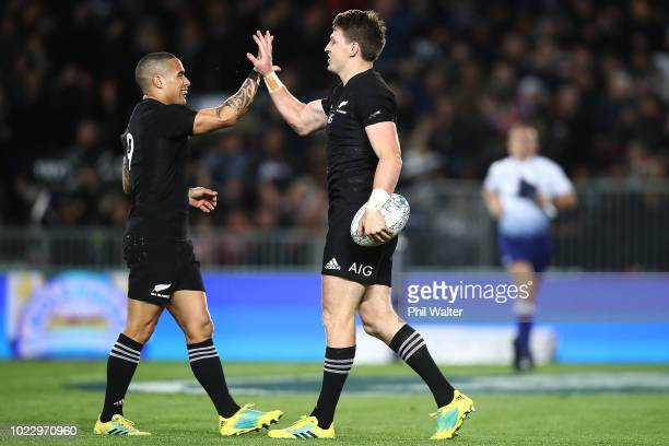 Beauden Barrett of the New Zealand All Blacks celebrates his try with Aaron Smith during The Rugby Championship game between the New Zealand All...