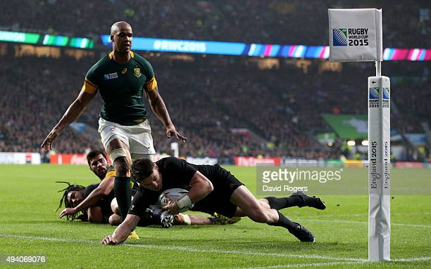 Beauden Barrett of the New Zealand All Blacks scores the second New Zealand try as JP Pietersen of South Africa covers during the 2015 Rugby World...