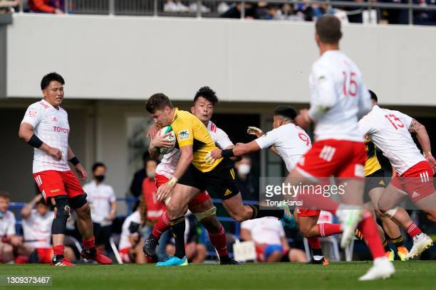 Beauden Barrett of the Suntory Sungoliath is tackled by Toyota Verblitz defense during the Top League match between Toyota Verblitz and Suntory...