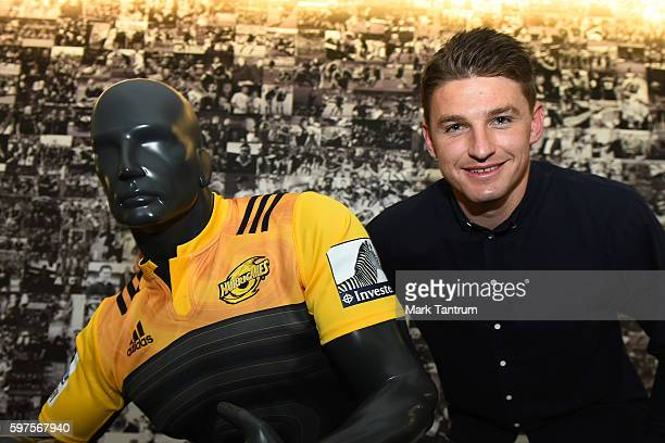 Beauden Barrett poses with a mannequin wearing a Hurricanes jersey after resigning with the All Blacks and Hurricanes teams at New Zealand Rugby on...