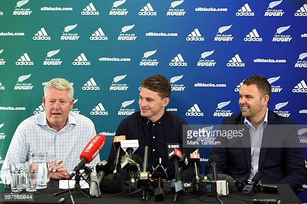 Beauden Barrett speaks to the media after resigning with the All Blacks and Hurricanes teams flanked by New Zealand Rugby Chief Executive Steve Tew...