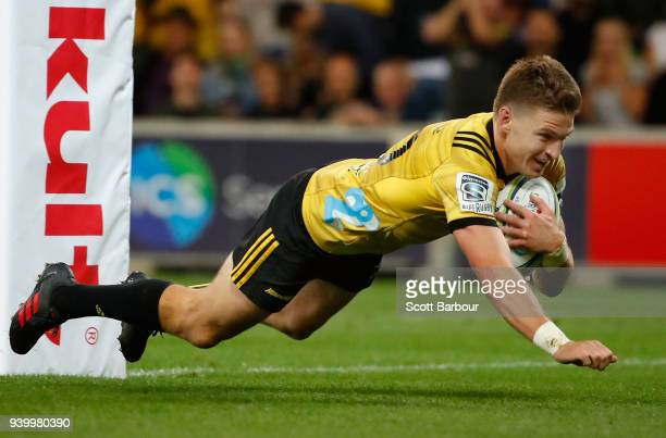Beauden Barrett the Hurricanes dives to score a try which was later disallowed during the round seven Super Rugby match between the Rebels and the...