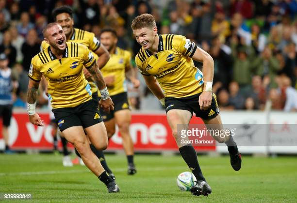 Beauden Barrett the Hurricanes scores a try as TJ Perenara celebrates during the round seven Super Rugby match between the Rebels and the Hurricanes...