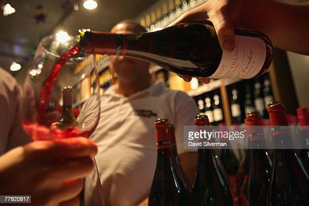 Beaujolais Nouveau 2007 wine is opened during a celebration for the young wine moments after midnight November 15 2007 in Tel Aviv Israel According...