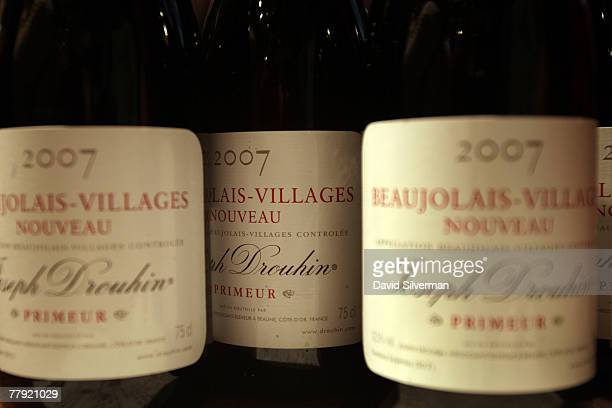 Beaujolais Nouveau 2007 wine is served during a celebration for the young wine moments after midnight November 15 2007 in Tel Aviv Israel According...