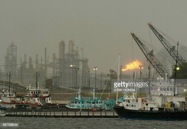 A flame from an oil refinery is blown sideways as winds increase in the Beaumont Texas harbor onm Friday 23 September 2005 as Hurricane Rita...