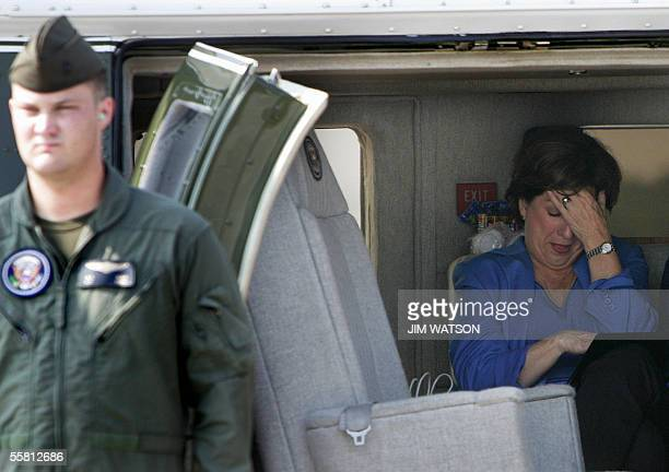 Lousiana Governor Kathleen Blanco waits inside Marine One for US President George W Bush at the South East Texas Regional Airport 27 September 2005...