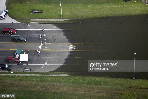 This aerial view shows a flooded street after Hurricane Rita in Beaumont Texas 25 September 2005 Hurricane Rita pounded the US Gulf Coast leaving...