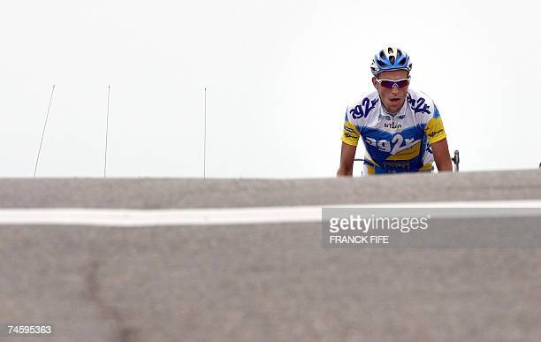 Beaumont-du-Ventoux, FRANCE: French Christophe Moreau is pictured as he crosses the finish line of the fourth stage of the Dauphine Libere criterium...