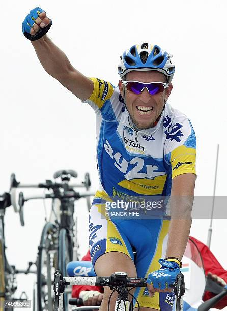Beaumont-du-Ventoux, FRANCE: French Christophe Moreau raises his arm in victory as he crosses the finish line of the fourth stage of the Dauphine...