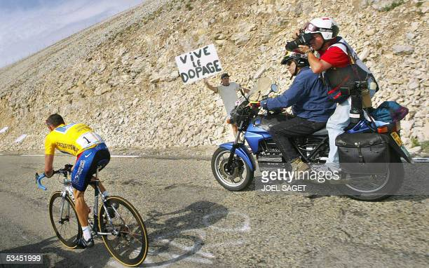 Picture shows yellow jersey US Lance Armstrong climbing the Mont Ventoux next to a banner against doping during the 14th stage of the 89th Tour de...