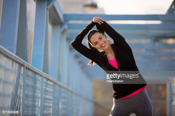 Beautful smiling woman stretching for exercising