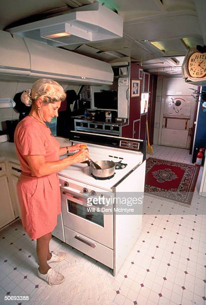 Beautician Jo Ann Ussery cooking at home which is converted Boeing 727 fuselage