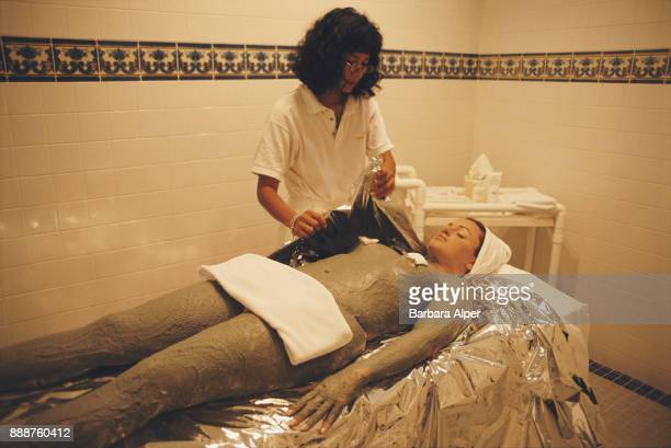 A beautician preparing a woman for a seaweed wrap spa treatment Bonaire Netherlands Caribbean March 2000