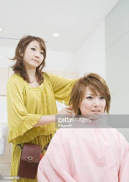 Beautician setting hair