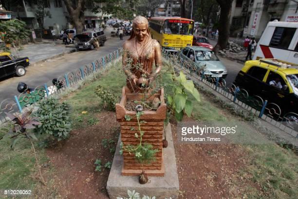 Beautification Mumbai A woman watering Tulsi plant a Sculpture laid by BMC Mayor Shubha Raul in Mumbai at Ruia college