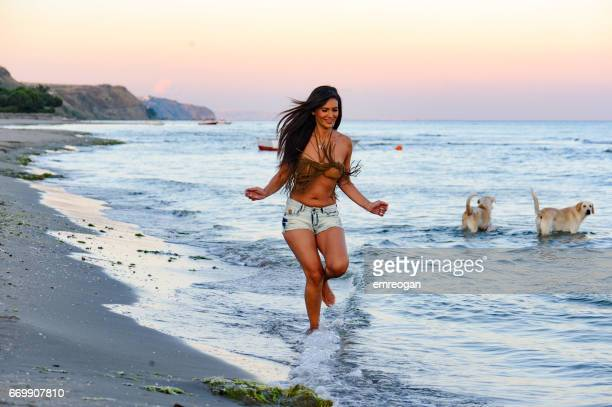 beautifu woman running on the beach - jumping stock pictures, royalty-free photos & images