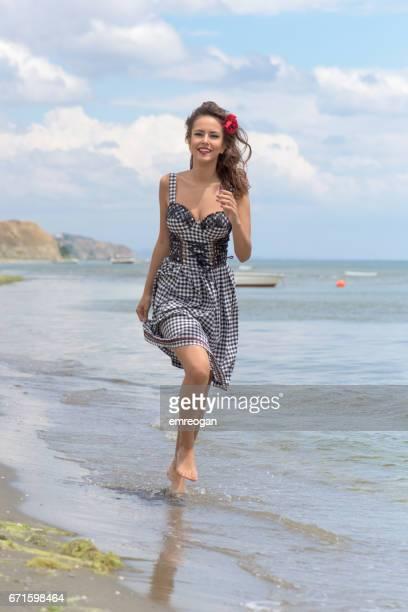 Beautifu woman running on the beach