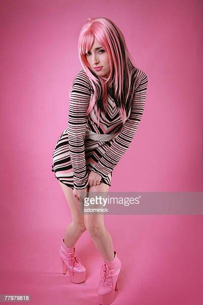a beautiful 70's style model posing. - mini dress stock pictures, royalty-free photos & images