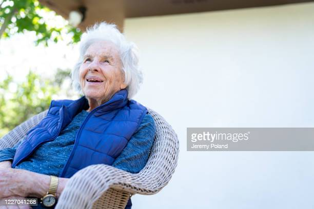 beautiful 90 plus year-old elderly senior caucasian woman sitting outdoors in the summer - 90 plus years stock pictures, royalty-free photos & images