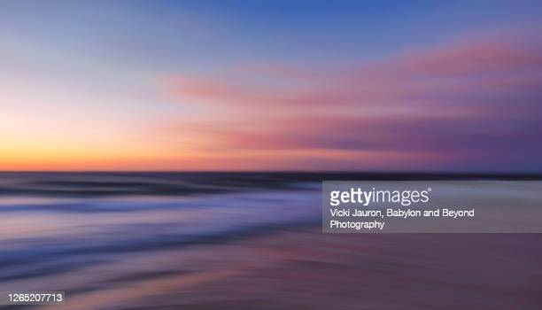 beautiful abstract blue and pink seascape at jones beach, long island - 空気感 ストックフォトと画像