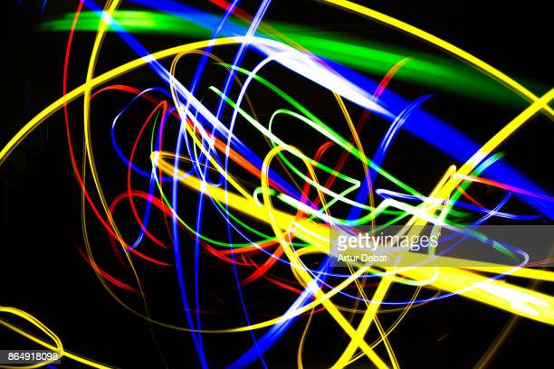 Beautiful abstract pictures with colorful lights painting at dark night with strong and aesthetic trace creating picture with energy and character.