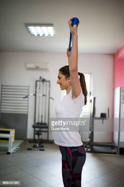 beautiful active woman working out at the fitness studio - elastic bandage stock photos and pictures