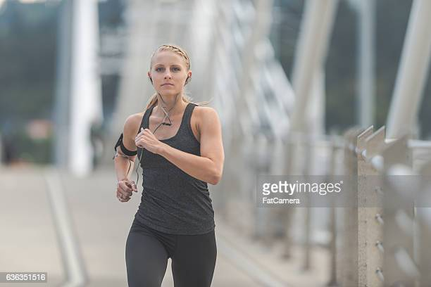 beautiful adult female running out in the city - women wearing spandex stock photos and pictures