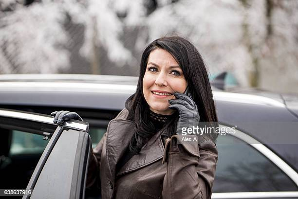 beautiful adult woman talking on the phone - next to stock pictures, royalty-free photos & images