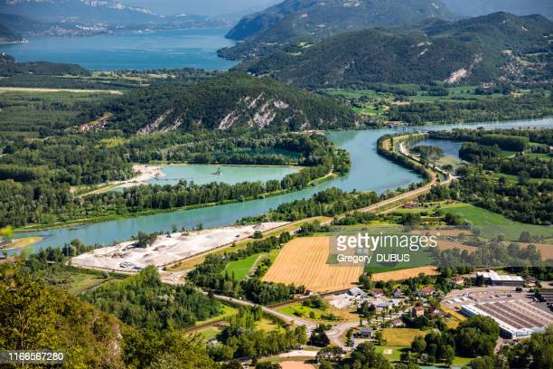 beautiful aerial view french summer landscape viewed from grand colombier summit in middle of bugey mountains in ain department, with rhone river, vibrant green fields and lake bourget in savoie - auvergne rhône alpes stock pictures, royalty-free photos & images
