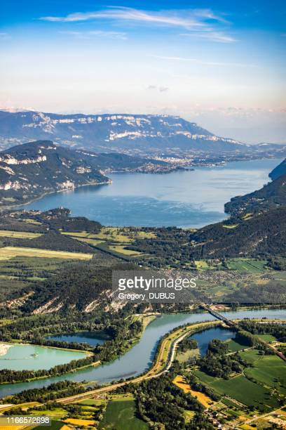 beautiful aerial view french summer landscape viewed from grand colombier summit in middle of bugey mountains in ain department, with rhone river, vibrant green fields and lake bourget in savoie - grand colombier ain stock pictures, royalty-free photos & images