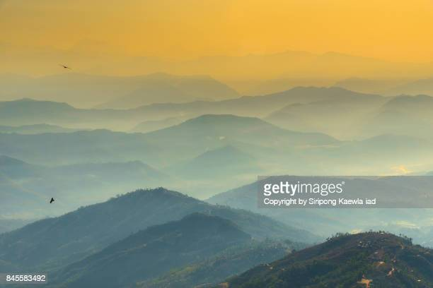 Beautiful aerial view of Himalayas mountain and hills with morning fog during sunrise in Nagarkot, Nepal.