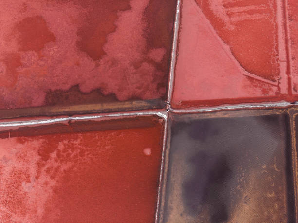 Beautiful aerial view of red salt flat pattern in the nature.