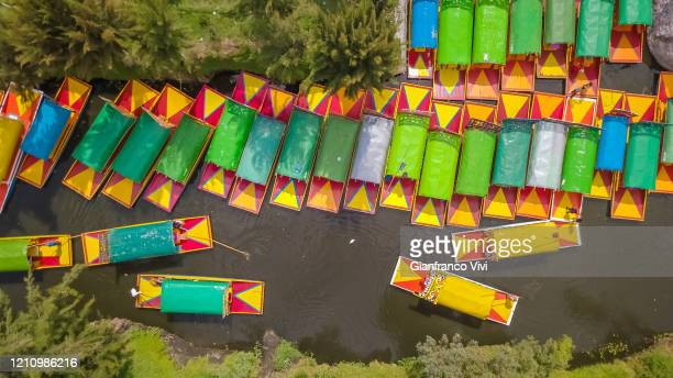 beautiful aerial view of the canals of xochimilco in mexico city - gondola traditional boat stock pictures, royalty-free photos & images