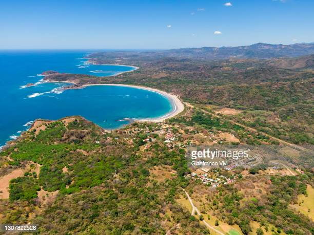 beautiful aerial view of the carrillo beach and ocean in costa rica - guanacaste stock pictures, royalty-free photos & images