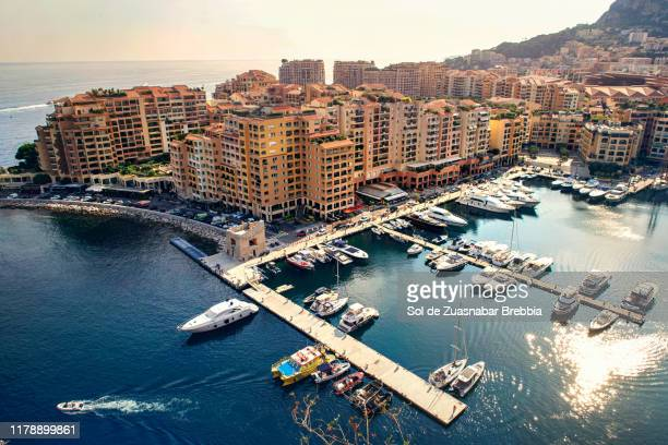beautiful aerial view of the city and pier of monaco on a bright sunny day - monaco stock pictures, royalty-free photos & images