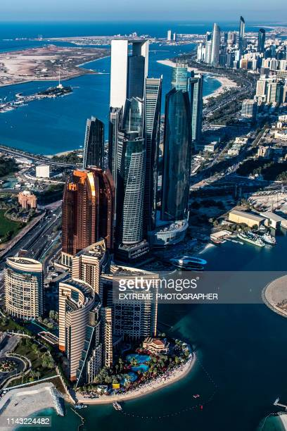 beautiful aerial view of the famous abu dhabi high-rise buildings, taken from a helicopter, united arab emirates - abu dhabi stock pictures, royalty-free photos & images