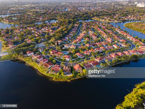 beautiful aerial view of the luxurious suburbs in florida, fort lauderdale - sunrise fort lauderdale stock pictures, royalty-free photos & images