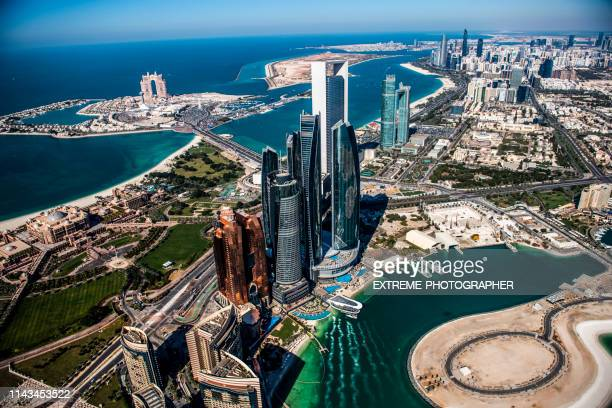 beautiful aerial vista of the famous abu dhabi skyscrapers, taken from a helicopter, united arab emirates - abu dhabi stock pictures, royalty-free photos & images