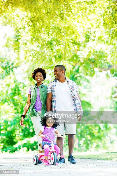 Beautiful African American Family having fun at the park