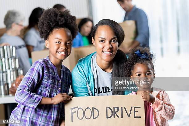 Beautiful African American family volunteer at a food bank