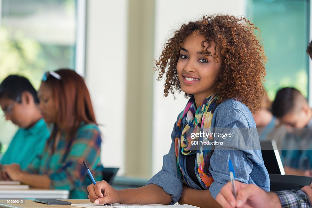 Beautiful African American Female Teenage College Student In Classroom
