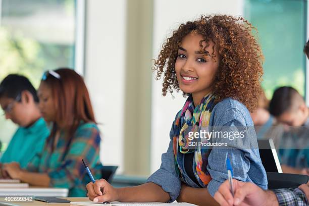 beautiful african american female teenage college student in classroom - pretty girls stock photos and pictures