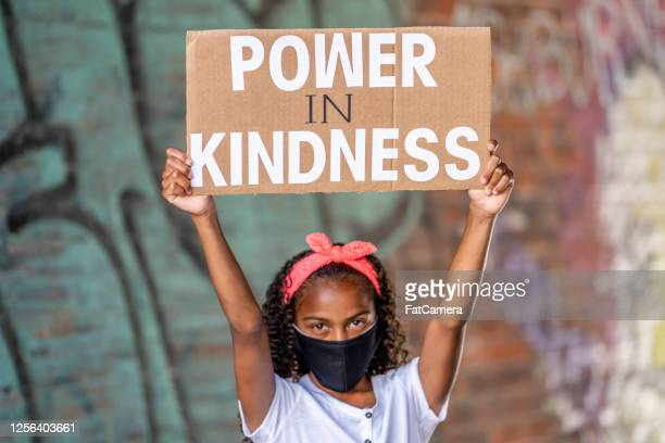 beautiful african american girl holding a protest sign - anti racism stock pictures, royalty-free photos & images